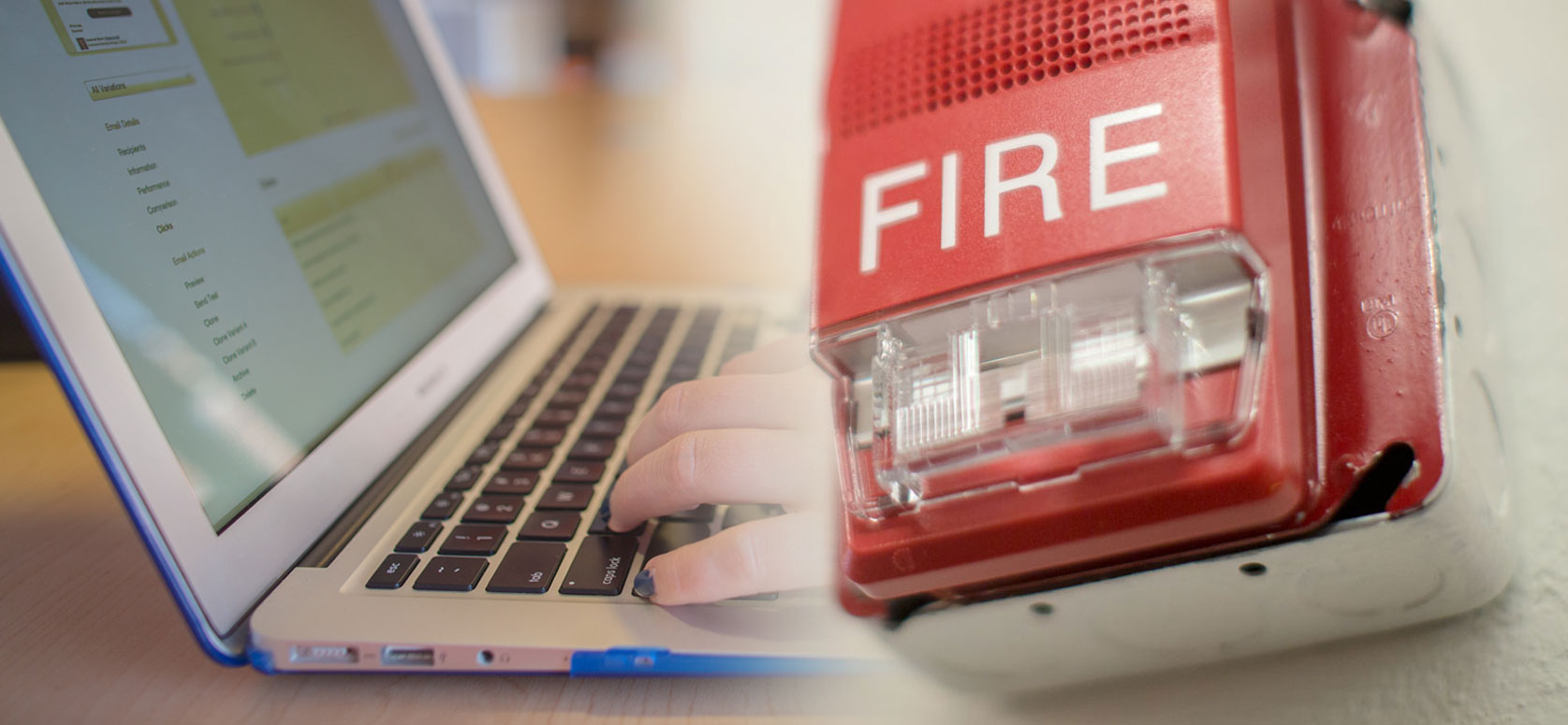 Laptop keyboard, screen and fire alarm